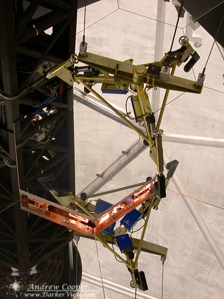 the segment crane being lowered into place to remove a segment from a primary mirror