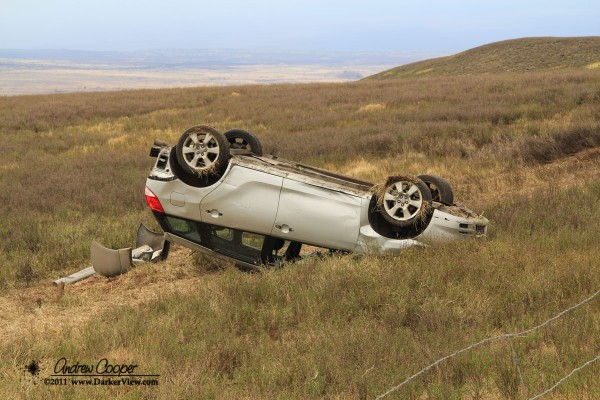 An overturned Toyota lies just of Saddle Road below Kilohana