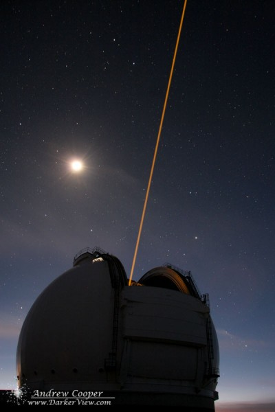 The Keck 2 AO Laser attempting the first target of the night with the light of sunset and a setting Moon behind