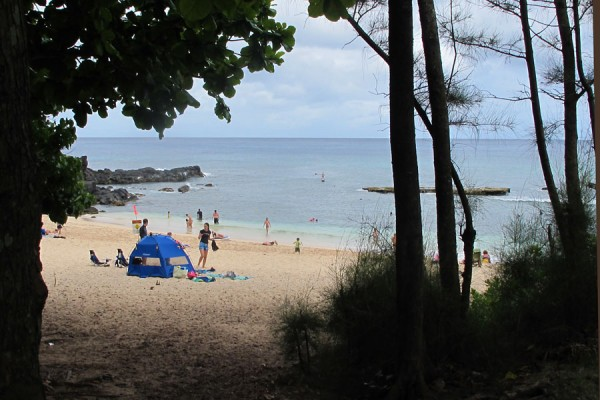The beach at Three Tables, North Shore, Oahu as seen from the parking lot