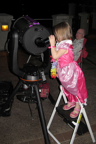 A princess looking through the telescope while we were set up at the King's Shops