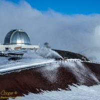 The MKSS snowplow crews remove snow from in front of IRTF Observatory atop Mauna Kea