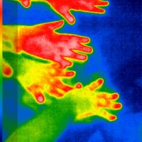 Thermal image of hands creating thermal handprints