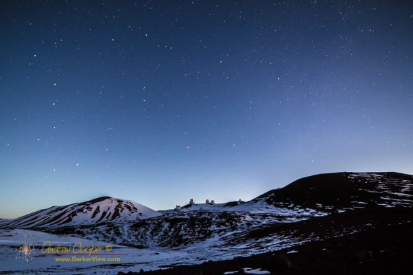 The telescopes of Mauna Kea on a snowy dawn