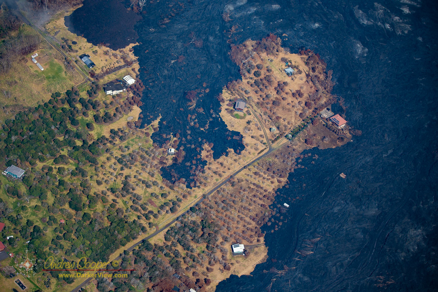 A few houses surrounded by devastation off Pohoiki Road, Puna