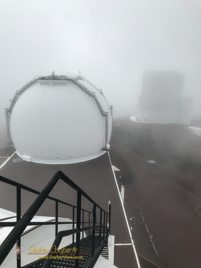 Fog wisps between the domes in this view from the top of Keck 2