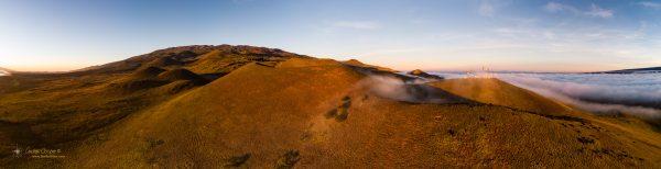 Mauna Kea lit in the reddish light of the setting Sun