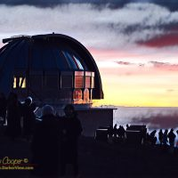 The United Kingdom Infrared Telescope surrounded by the sunset crowd