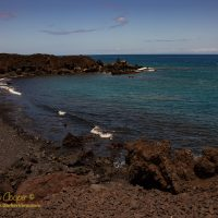 A black sand beach south of Kiholo Bay