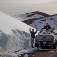 Driving to the summit of Mauna Kea to load snow into a pickup