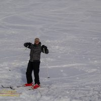A skier shows his delight at the end of a run down the slope on Mauna Kea
