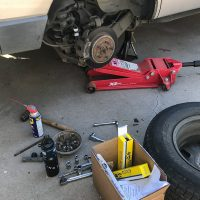 The vehicle up on axle stands while replacing the sway bar links
