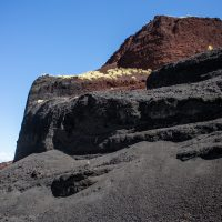 The tall cliffs of a cinder quarry in the south side of Puʻu Hinai