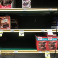 The brownie mix shelves with gaps of out-of-stock items
