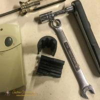 The broken drive coupler of a Chamberlain Liftmaster garage door opener